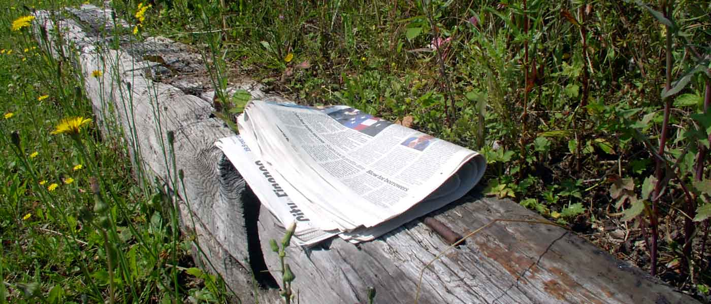 Newpaper on bench